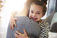 Happy daughter embracing mother - ABIF01188