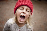 Playful girl shouting at forest - ASTF04934