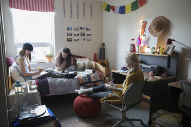 Female college students studying in dorm room - HEROF24712