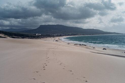 Spain, Tarifa, beach with footmarks in the sand - OCMF00292