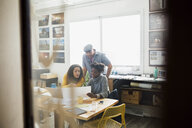 Designers reviewing paperwork in office - HEROF25153
