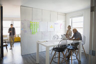 Business people brainstorming in conference room - HEROF25258