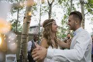 Bride and groom dancing at backyard wedding reception - HEROF25525