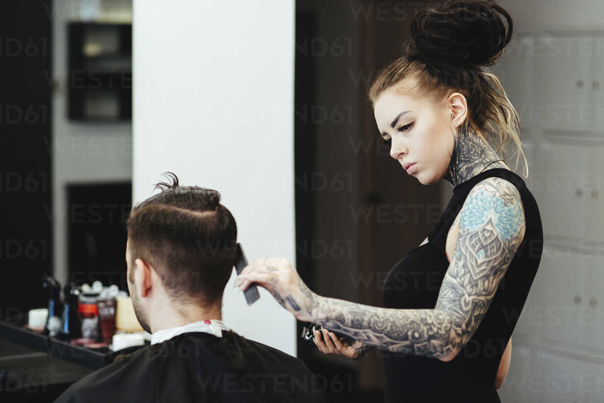 Side View Of Female Hairdresser Cutting Male Customer S Hair In Salon Cavf60763 Cavan Images Westend61