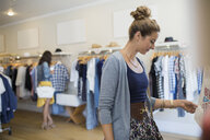 Woman browsing in clothing shop - HEROF25808