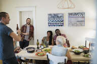 Friends enjoying dinner party at dining table - HEROF26057
