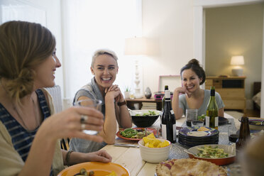 Friends laughing and enjoying dinner party - HEROF26087