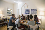 Friends enjoying dinner party at dining table - HEROF26090