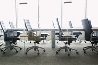 Chairs around empty conference room table - HEROF26257