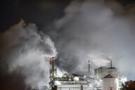 Smoke emitting from factory at night - CAVF61247