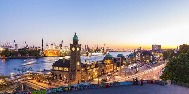 Germany, Hamburg, Port of Hamburg and Landungsbruecken at dusk - WDF05151
