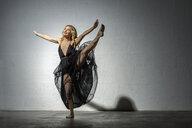 Blond woman dancing in black dress - VGF00214