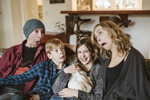 Playful, silly family making faces - CAIF22880