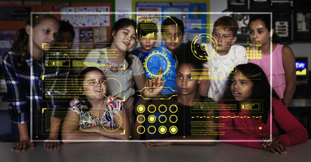 Junior high school students using futuristic touch screen in classroom - CAIF22937