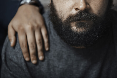 Bearded man with boyfriend's hand on his shoulder, partial view - AZF00133