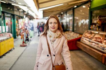 Austria, Vienna, portrait of smiling young woman shopping at Naschmarkt - ZEDF01930
