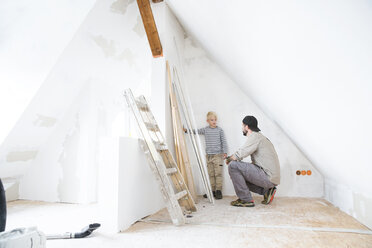 Father and son planning loft conversion - MFRF01165