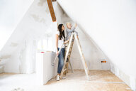 Mother and son working on loft conversion - MFRF01174