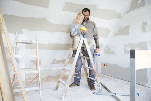 Father and son working on loft conversion - MFRF01189