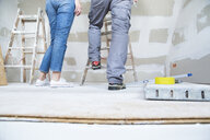 Legs of couple with ladder in attic to be renovated - MFRF01201