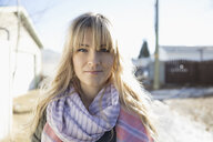 Portrait confident, serious blonde woman wearing scarf on sunny road - HEROF26537