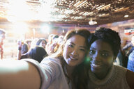 Personal perspective women friends taking selfie at party - HEROF26564