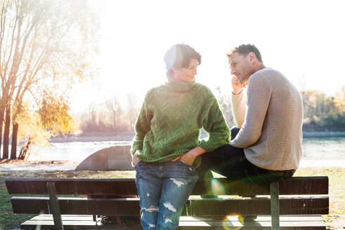 Couple looking worried on park bench, Strandbad, Mannheim, Germany - CUF49286