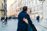 Couple hugging at piazza, Firenze, Toscana, Italy - CUF49439