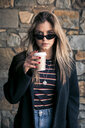 Portrait of young woman with sunglasses and coffee to go - ACPF00471