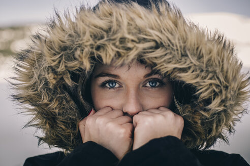 Portrait of young woman wearing hood in winter - ACPF00477