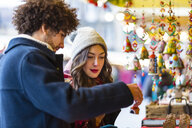 Young couple at a stall on Christmas market - MGIF00303