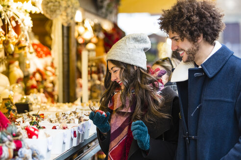 Young couple at a stall on Christmas market - MGIF00306