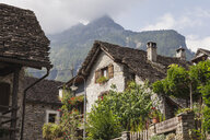 Switzerland, Ticino, Sonogno, typical historic stone houses - GWF05967
