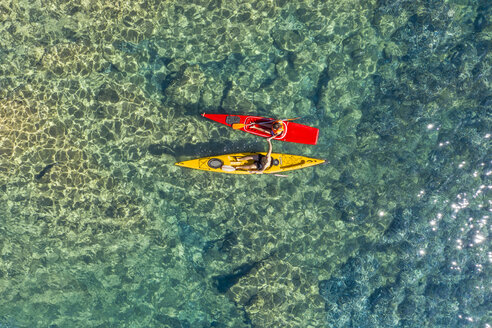 Drone shot of couple kayaking together in sea during sunny day - CAVF62406