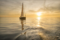 Germany, Baden-Wuerttemberg, Lake Constance, sailing boat at sunset - SH02050