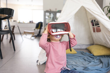 Little girl playing with VR goggles - JOSF03120