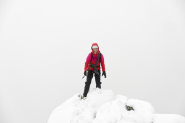 UK, Scotland, Glen Spean, woman on peak of Beinn a Caorainn in winter - ALRF01418