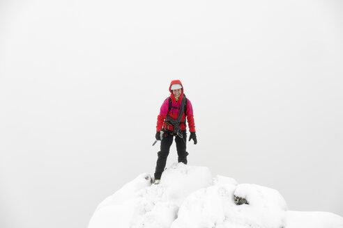 UK, Scotland, Glen Spean, woman on peak of Beinn a Caorainn in winter - ALRF01418