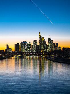 Germany, Hesse, Frankfurt, Skyline of financial district, Main river and Deutschherrn Bridge at sunset - AMF06806