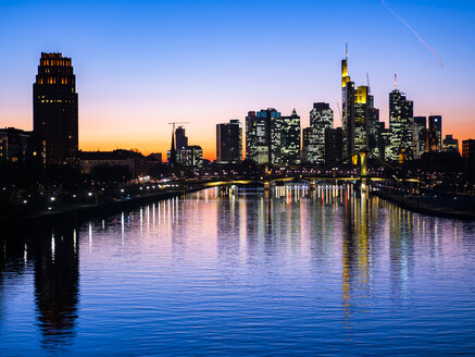 Germany, Hesse, Frankfurt, Skyline of financial district, Main river and Deutschherrn Bridge at sunset - AMF06809