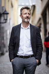 Portrait of mature businessman with greying beard in the city - DIGF06019