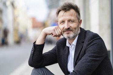 Portrait of content mature businessman with greying beard - DIGF06025
