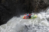 Man kayaking on waterfall on river - ALRF01432
