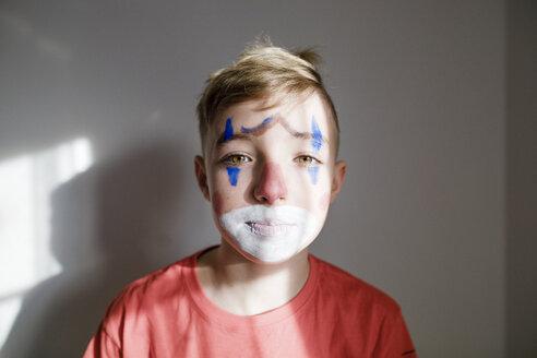 Portrait of sad boy made up as a clown - KMKF00779