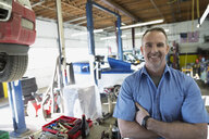 Portrait confident mechanic in auto repair shop - HEROF27269