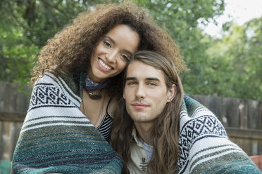 Portrait young couple wrapped in a blanket - HEROF27308