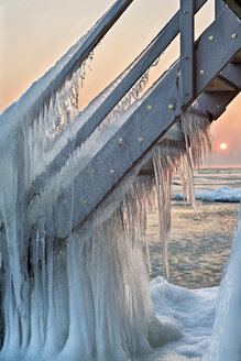 Switzerland, Thurgau, Lake Constance, Kesswil, icicles on the stairs of an old bath house and lake shore at sunrise - SH02084