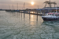 Germany, Baden-Wuerttemberg, Lake Constance, Constance, ice floes around ship and empty jetties with dolphins in the harbor at sunrise - SH02096
