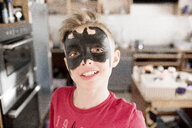 Boy made up as batman - KMKF00795
