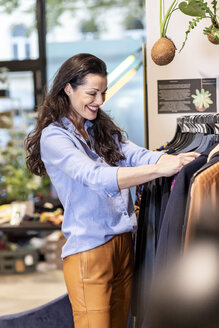 Mature woman shopping for clothes in a fashion store - PESF01534